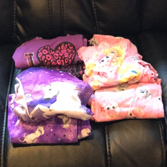 Other - All 7 pairs of girls pajamas top an bottom